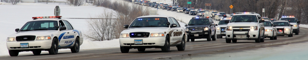 squad cars in funeral procession