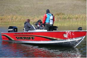 Douglas County Sheriff's Office Dive Team members in a boat